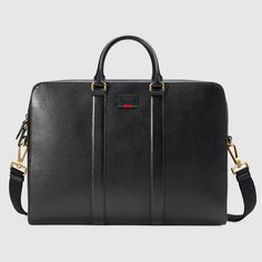 Shop the Leather briefcase with Web by Gucci. A single gusset leather  briefcase with our Gucci embossed tag and signature green and red Web  detail. Made in ... 4e22c4ca4ecf3