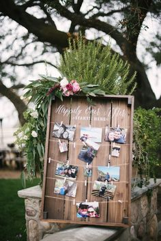 Creative wedding sign idea - wooden pallet box with family photos hung on clotheslines {Walking Eagle Photography}
