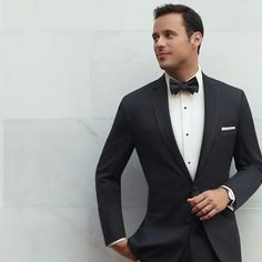 A black tuxedo complemented with a white shirt and #pocketsquare is a classic look for formal occasions. #Groom #Wedding #MenWithStyle