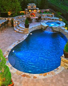Perfect backyard pool with hot tub and fire place