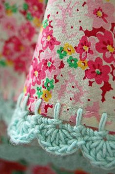 pillowcase with crochet trim Pretty Meadow by rosehip on Etsy.    Yarn color doesn't HAVE to be one of the colors in the fabric to look fabulous.