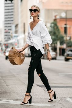 Blonde Woman Wearing Club Monaco Ruffle Sleeve Wrap Top Cult Gaia Ark Bag Black Ripped Skinny Jeans Street Style Outfit