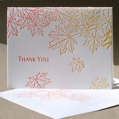 Rocked by a gentle fall breeze, a maple tree shakes loose a few brightly-hued leaves. Letterpress printed in red and orange inks on pearl white paper, this Thank You card's interior is blank and ready for your personal message.    This card is also available as a blank note. $5 Letterpress