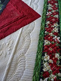 Love the border  -  Christmas in June.  quilted by Margaret of Quilts of Love