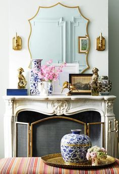 Adorn your carved marble fireplace with gilded gold accents and blue and white Chinoiserie for a bright, classic take on spring decor. Fireplace Mantle, Living Room With Fireplace, Living Room Decor, Christmas Fireplace, Fireplace Ideas, Mantle Mirror, Fireplace Furniture, Fireplace Decorations, White Fireplace