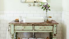 Vintage Bathroom - Farmhouse Restoration Idea House Tour - Southern Living - Give a new room instant age.
