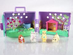 #Tonka Littlest #Pet Shop #1995 #vintage Run n Fun #Puppy Play Yard assortment with four (4) #puppies #dog #dogs from Country Fun #Pets #collection with closure, carrying case, wheel gear for spinning and #small #mini babies #collectible #toy #play #set in painted scene with grass, flowers, fence and doghouse, excellent used condition…