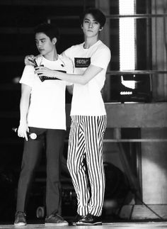 I love pictures of satansoo next to my biases because we are the same height I mentally replace him with myself