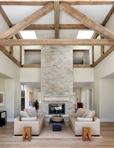 Love the beams and fireplace. Would want warmer decor and furnishings... Farmhouse Living Room Design Ideas, Pictures, Remodel and Decor