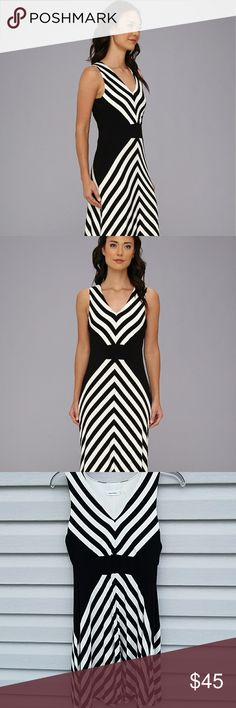 """NWT Calvin Klein V-neck Stripe Black & White Dress Beautiful v-neck summer dress, could be casual or dressed up. The placement of the stripes and black make this dress so figure flattering.   It's brand new with tag attached.   95% Rayon 5% Spandex  Has a good bit of stretch.   17"""" underarm to underarm  14"""" across where the black stripe goes across 38"""" shoulder to hem Calvin Klein Dresses Midi"""