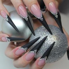 black stiletto these are also really cute nails i got them one time myself and they are quite hard to use since they are so long but i would recommend them!