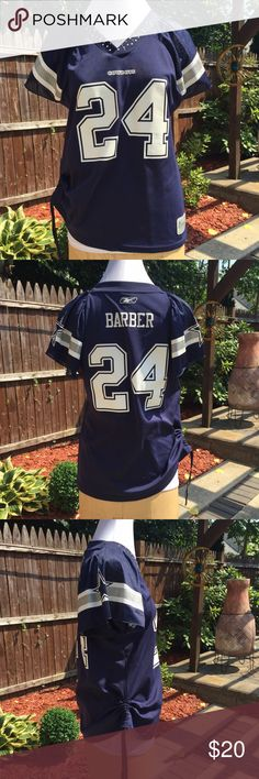 COWBOYS Marion Barber III NFL Team Apparel Reebok COWBOYS Marion Barber III NFL Team Apparel Reebok Jersey.  100% Polyester.  Crystal along the neckline Reebok Tops