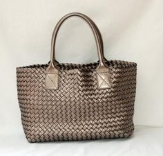 Bottega Veneta Mini Cabat Armatura Special Order tote. This is probably the most amazing Bottega Veneta Cabat made. This was a special order (30% markup by BV for special orders) Mini Cabat made in 2009. Bottega Veneta has discontinued the Mini (Asian) size Cabat and metallic Armatura is no longer available for special order. This is a one of a kind Cabat, Armatura color is closest to Platinum.