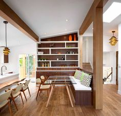 Dining Room Design Ideas - Use Built-In Banquette Seating To Save Space // A glass table top helps make this small built in banquette feel larger and accentuates the use of various types of wood throughout the kitchen.