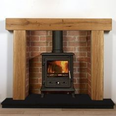 Fantastic Photo Brick Fireplace with oak beam Ideas Sometimes it makes sense to neglect the actual upgrade! Instead of removing a great dated brick fireplace , spend less w Oak Beam Fireplace, Wooden Fireplace Surround, Oak Fire Surround, Log Burner Fireplace, Wood Burner, Fireplace Surrounds, Fireplace Design, Wooden Mantel, Wood Stove Surround