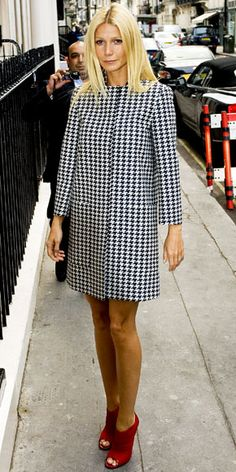 Gwyneth Paltrow headed into London's Arts Club for a Coach dinner in a houndstooth trench and leather Jimmy Choo booties. Houndstooth and Red shoes (two fall must haves)