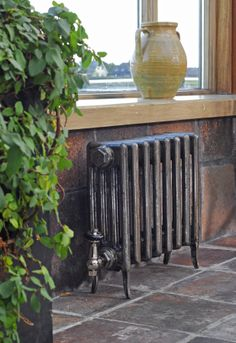 'The Neo-classic' Cast Iron Radiator, in full polish finish, available from Ribble Reclamation Electric Radiators, Cast Iron Radiators, Apartment Makeover, Vintage Parts, Rear Window, Interior Design Inspiration, Home Appliances, Flooring, House Exteriors