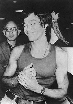 Bruce Lee and Raymond Chow at Kai Tak airport