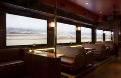 THE PASSENGER, a coffee shop in Madrid with screens for windows that play recordings of train travel throughout the world. NationalTraveller.com