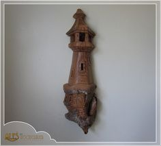 Whimsical lighthouse fully hand carved out of a single piece of cottonwood bark with a real acorn in its tower. This nice and detailed carving