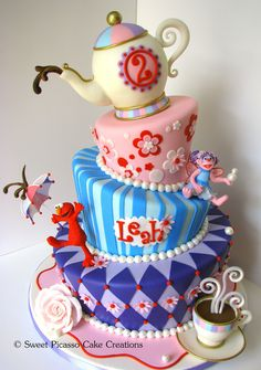 """I finally had the opportunity to make my first topsy turvy cake.  Such fun!  12"""", 9"""", 6"""" tiers with RKT teapot on top.  Gumpa..."""