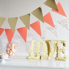 Add a festive touch to your next celebration with this DIY Paper Craft-It™ Coral and Gold Paper Banner