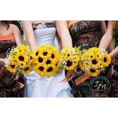 Sunflowers and a country theme. #wedding #country #hunting #camo #sunflowers