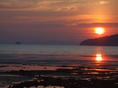 """Beautiful sunset in Krabi on Ao Nang beach. Love this place! I can still hear the Thai boat operators yelling """"ao nang"""" ao nang"""" ao nang""""...:)"""