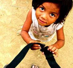 Little girl in Moyogalpa is obsessed with my backpack and tries to buckle me in.