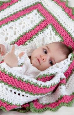 Summer Baby Blanket Crochet   Crochet the perfect blanket for a special baby. This one is crocheted in pretty shell stitch panels that are joined as you go. If expecting a boy, it would be just as nice in blue instead of pink. Red Heart Free Pattern - no membership required