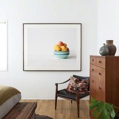 This room is quite calm, but using a large picture with a clear area contained within the frame can calm an otherwise busy room. Look for an image with a large flat area of colour or use a small image with a large mount.  Aiala Hernado (print)