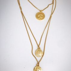 Gold coin medallion and heavy chains are the trend started by Kim Kardashian! Gold filled and great quality.