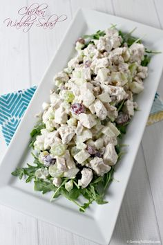 Fresh Chicken tossed with apples, grapes, and crunchy walnuts and drizzled with a lemony yogurt dressing. This Chicken Waldorf Salad is a light modern twist on a classic favorite and it's pefect for a summer picnic! #BloggerCLUE | Cooking In Stilettos