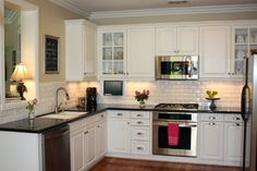 I think this white cabinet/dark counters color-scheme could work in the new kitchen.