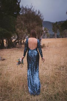 A blue sequin wedding dress for a colourful and flower filled picnic wedding. Photography by Sarah Burton.