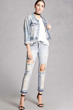 A pair of skinny jeans by Korirl™ featuring a destroyed design, five pocket construction, mid-rise, and a zip fly.