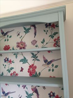 The power of paint and paper - bookcase completely transformed using Annie Sloan paint & Laura Ashley wallpaper.  Sorry Cath Kidston but Laura Ashley has more class.