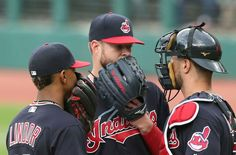 Cleveland Indians Corey Kluber talks with catcher Yan Gomes and Francisco Lindor in the first inning against the Houston Astros at Progressive Field,  on April 27, 2017.   (Chuck Crow/The Plain Dealer). Indians won 4-3