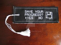 A geeky bookmark for my IT tech father. The edges were surged to prevent fraying and then it was sewn onto a piece of white felt. The tassel is made of embroidery thread. Pattern by: passionfyre.de...