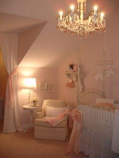 love the soft pink, feminine details of this baby girl nursery. I want a chandelier in my girls rooms so badly!