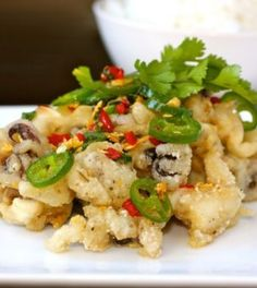 Chinese salt and pepper squid - I could eat this all day long with ice cold ging. ♡ Chinese salt and pepper squid - I could eat this all day long with ice cold ginger beer of all things. Calamari Recipes, Squid Recipes, Fish Recipes, Seafood Recipes, Asian Recipes, Appetizer Recipes, Cooking Recipes, Ethnic Recipes, Cooking Games