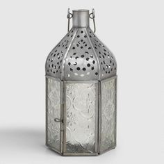 We traveled the world to find our tabletop lantern collection, handcrafted by artisans in India of glass and hand-punched iron with an antique zinc finish. Inspired by Moroccan and Mughal artwork, it makes a global style statement. www.worldmarket.com #WorldMarket Outdoor
