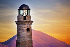 The old Venetian lighthouse against Psiloritis mountain-by-Theophilos Photos Of The Week, Greece Travel, Empire State Building, Venetian, Old Things, Image, Lighthouses, Mountain, Colors
