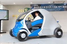 This electric car folds up to save space when parked. How nuts is that?