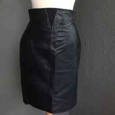 """Black Plonge lamb leather skirt vintage 90's sz 8 Incredibly thick supple Plonge lamb leather skirt bought in the 90's , worn a few times and stored very well. 23"""" from the waistband top to the hem bottom. The tag says size 10 but it really fits 6-8. Fully lined. This is so easy to wear, the waistband has a """"V"""" in the front of elastic! Sexy and easy to wear!! Maxima Skirts"""
