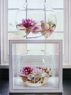 Goldfish bowl and flowers.