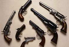 Selection of Pistols: Variety of Civil War handguns including a Pepperbox (top) and on the far right a Model Colt .36 navy Revolver. (Photo Credit: Tria Giovan/CORBIS)