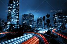Los Angeles, Urban City at Sunset with Freeway Trafic by EpicStockMedia. Modern Urban City at Sunset