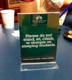 "Sign saying: ""Please do not stand, sit, climb, or sharpie on sleeping students."""