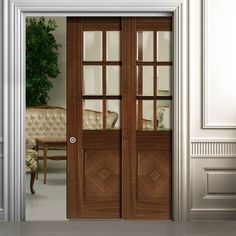 Deanta Twin Telescopic Pocket Kensington Walnut Veneer Doors - Clear Bevelled Safety Glass - Prefinished.  #slidingdoors  #walnutdoors  #pocketdoors
